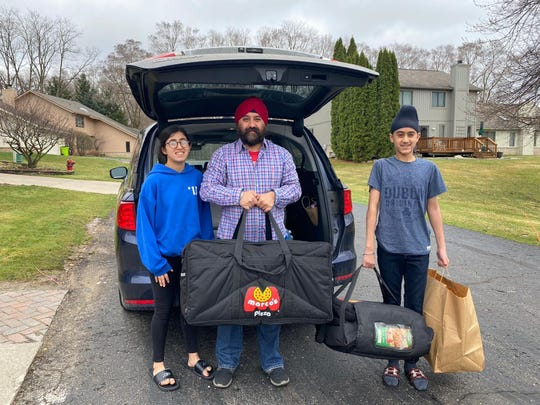 Shalinder Singh with his children, Baani and Arjun, before a recent delivery.