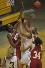 Carolyn Davis blocking a shot.