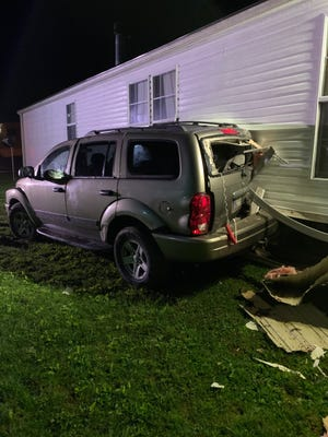 This Dodge Durango, driven by Robin Jeanne Bates of Evansville, caused damage to a home Friday evening in the 8400 block of Rainier Drive. Bates was intoxicated at the time of the crash.