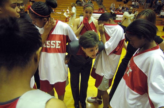 Bosse head coach Angie Oliver speaks to her disappointed players after the girls lost to Brebeuf Jesuit 55-53 in a close Class 3A semistate championship game in 2007.