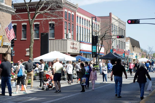 Social distancing, face masks and fewer vendors was the scene Saturday, May 16, 2020 at the first farmers market of the year in Downtown Fond du Lac, Wis. Doug Raflik/USA Today NETWORK-Wisconsin