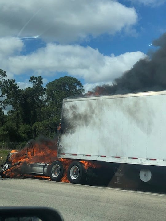 A truck on fire in the southbound lane of Interstate 75 near mile marker 143 in North Fort Myers on Saturday, May 16, 2020.