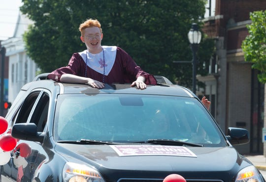 Ben Laird rides down Second Street in Downtown Henderson, Ky., during graduation parade for the Henderson County High School Class of 2020 at HCHS Saturday morning, May 16, 2020.