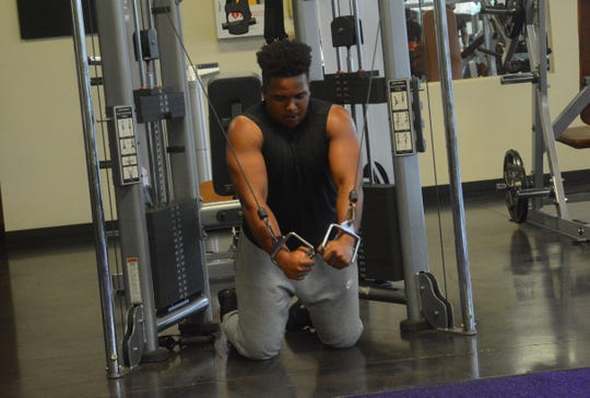Moses Green returns to the gym at Anytime Fitness in Jackson for the first time in weeks. Green was joined by four other gym patrons, each being careful to socially distance from one another on Saturday, May 16, 2020.