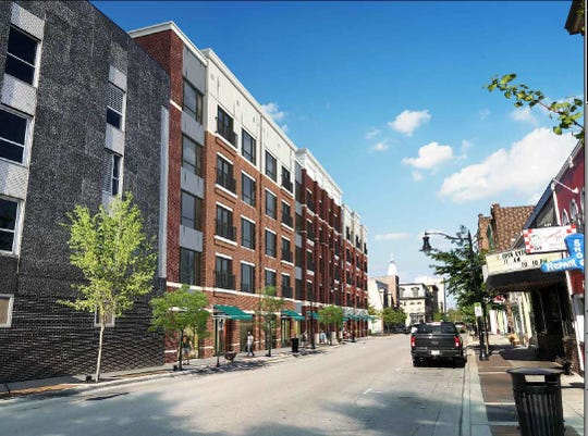 A five-story $20 million project at 631 Main St. would put retail space and 100 upper-level apartments in a spot that has been a private parking lot for a half-century. Developers said construction could start in October 2020 and finish by April 2022.