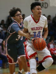 New UL signee Brayan Au (14, right) is fouled while playing for Anthony High in Texas.