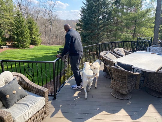 With Michigan State athletic events currently shut down due to the coronavirus, Mel Tucker often works from his back deck in the company of his two English white labs, KJ and PJ.