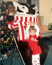 A very young Kristin Brey with the Bucky Badger mascot.