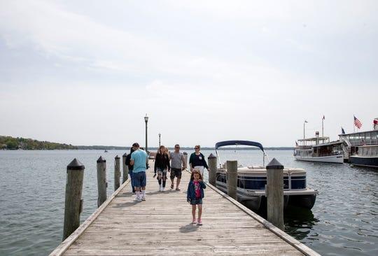 People enjoy the water at Lake Geneva on Saturday.