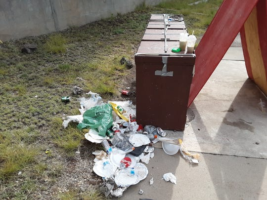 Trash located near the bear-proof waste receptacles