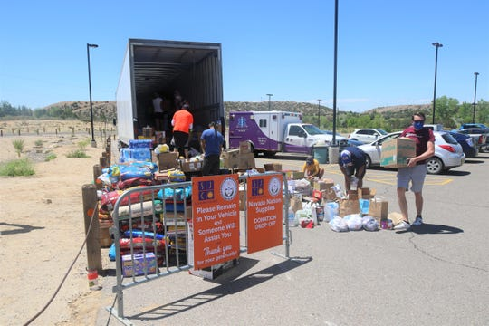 Volunteers from San Juan College load items for Navajo Nation residents into a 48-foot trailer on May 16, 2020, at the conclusion of a week-long donation drive on the college campus in Farmington.