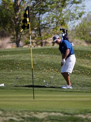2019 Piedra Vista boys golf graduate Trey Diehl chips his ball toward the hole on Tuesday, May 8, 2018, at Piñon Hills Golf Course in Farmington. The course is back to operations after lengthy closure due to the COVID-19 pandemic.
