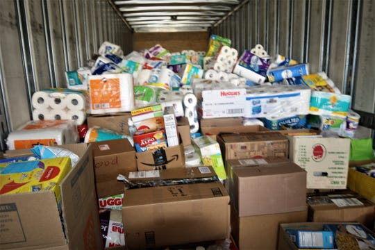 Boxes of nonperishable food, diapers and packages of toilet paper bound for Navajo Nation residents are stacked nearly to the roof of a 48-foot trailer on May 16, 2020, the San Juan College campus in Farmington.