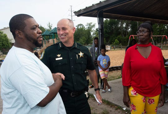 Escambia County Sheriff's Office Chief Deputy Chip Simmons meets DeVarrian Virgin, brother of Marcus Virgin, on Friday at Westernmark Park.