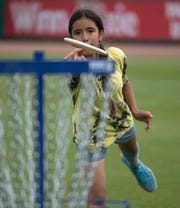 Violet Holst plays a round of disc golf at the new course designed by Bubba Watson at the Blue Wahoos Stadium on Friday.