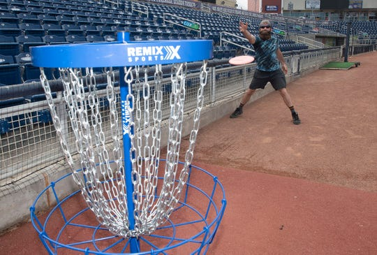 Joey Napoli plays the new disc golf course designed by PGA Golfer Bubba Watson at the Blue Wahoos Stadium on Friday, May 15, 2020.