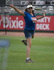 Sharon Holst tackles the new disc golf course designed by Bubba Watson at the Blue Wahoos Stadium on Friday.