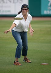 Kelly McClean tackles the new disc golf course designed by Bubba Watson at the Blue Wahoos Stadium on Friday.
