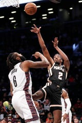 Atlanta Hawks forward Paul Watson (2) shoots with Brooklyn Nets center DeAndre Jordan (6) defending during the first half of an NBA basketball game, Sunday, Jan. 12, 2020, in New York. (AP Photo/Kathy Willens)