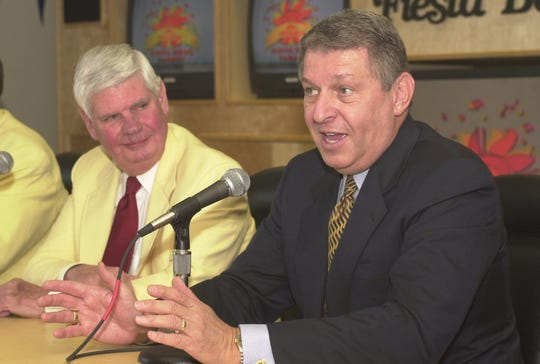 DIGITAL -- 21428 -- Bill Shover, left,  past Fiesta Bowl President, listens to  Jerry Colangelo  at a press conference at the Fiesta Bowl headquarters in Tempe where it was announced that Colangelo will be the honorary grand marshal of this years Microage Fiesta Bowl Parade. Russell Gates photo. 12/21/99