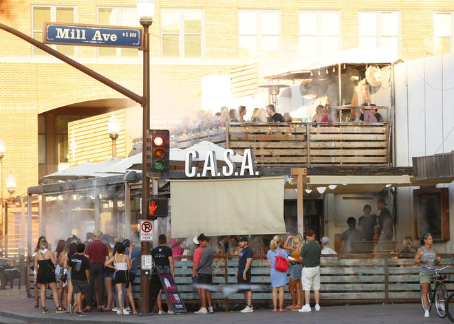 People pack into CASA Tempe on the first day of dine in reopening in Tempe, Ariz. on May 11, 2020.