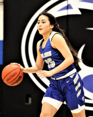 Valley Christian girls basketball forward Jada Pourier dribbles during a game in the 2019-20 season.