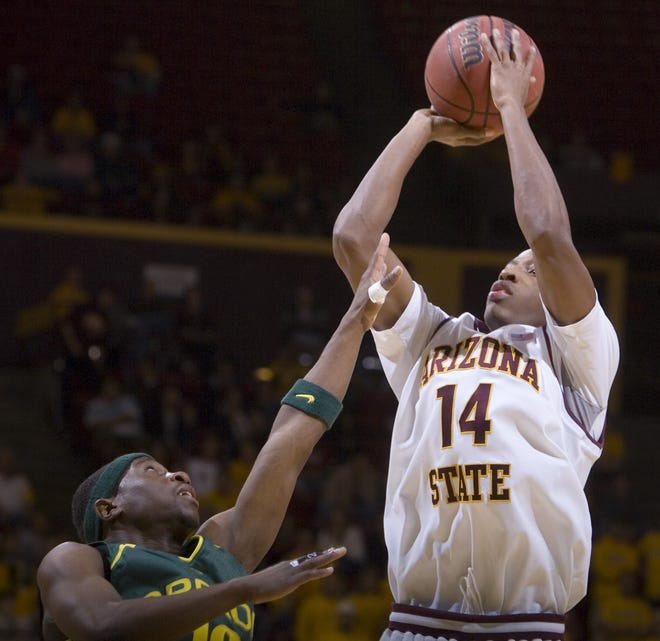 Arizona State guard Christian Polk shoots over Oregon guard Tajuan Porter in the second half of their game against Oregon at Wells Fargo Arena in Tempe on Thursday, Jan. 3, 2008.