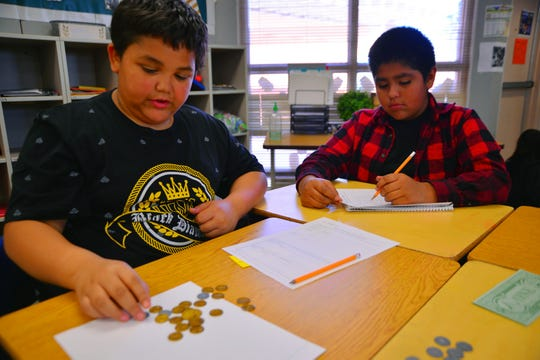 Whittier fifth graders Damian Green (left) and Jesse Valencia  work together on a math lesson in Andrea Steiner's class on March 5, 2020.