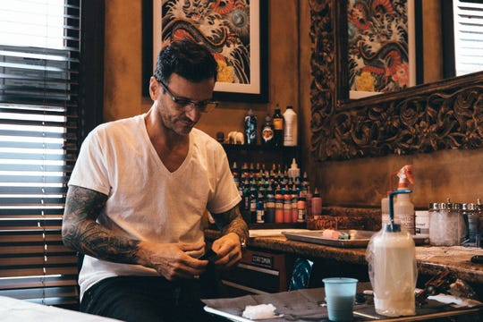 Mark Walters, owner of Living Canvas Tattoos in Tempe.