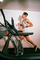 May 16, 2020; Ultramarathon runner Zach Bitter runs on the NordicTrack X22i in his attempt to break the 100-mile treadmill record at his home in Phoenix.