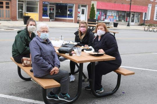 Four friends from Cleveland took advantage of the new outside patio dining setup along Madison Street in downtown Port Clinton.
