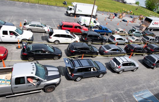 Cars fill the John Wright Restaurant's parking lot with their trunks open as the York County Food Bank's Pop-Up Drive-Thru Food Distribution is about to start, Saturday, May 16, 2020.
