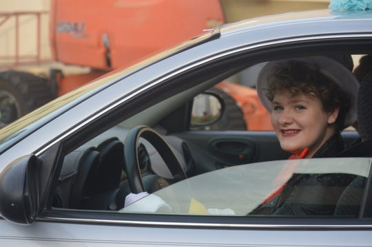 U-Prep senior Mickiela Holmquist drives in her car and maintains social distance during the Dr. Seuss themed Sober Grad Night at her school on Friday, May 15, 2020.