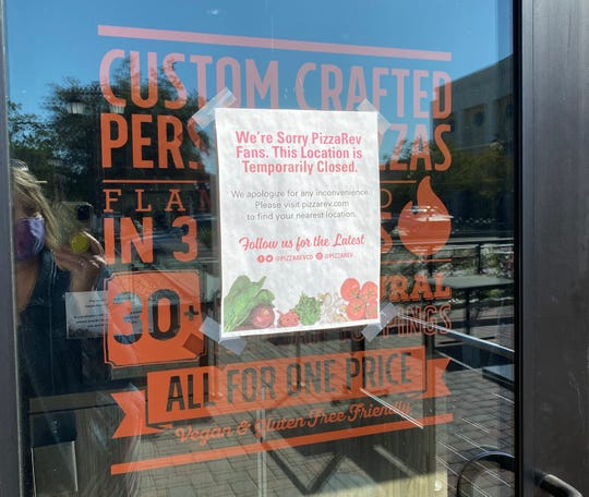 """A """"temporarily closed"""" sign is seen on the door at PizzaRev in Thousand Oaks. The chain has permanently closed all of its locations in Ventura and Santa Barbara counties. Only two remain in Los Angeles County."""