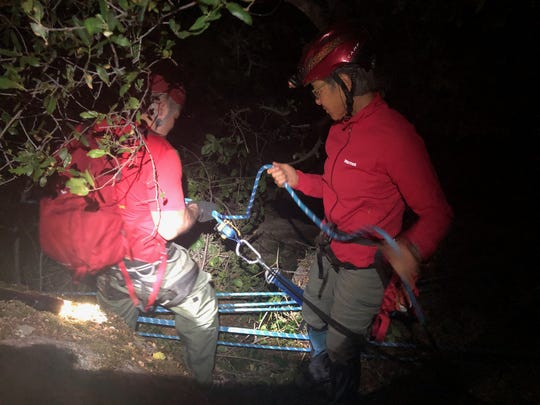 Multiple agencies spent Friday night rescuing a climber who fell into a ravine.