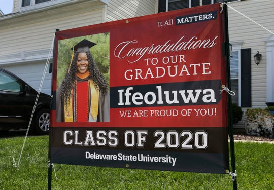 Campus was about 20 miles away on the campus of Delaware State University, but nursing student Ifeoluwa Fisher was taking part in remote-commencement with her family at their home in Townsend Saturday.