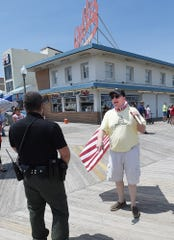 A rally to reopen Rehoboth Beach's boardwalk and beach was held on Saturday, May 16 at the Bandstand in downtown Rehoboth Beach with more than 100 protesters in attendance.