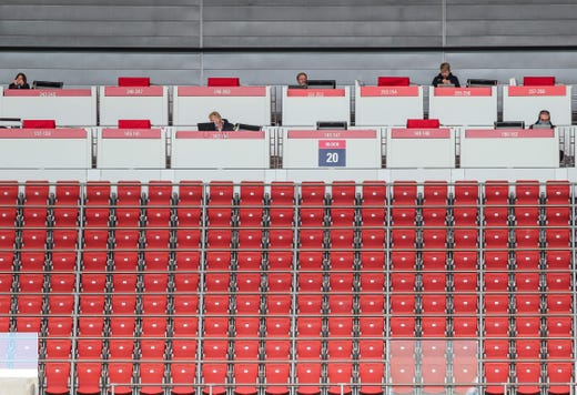 Journalists keep distance in the stands as they report from the German first division Bundesliga football match RB Leipzig v SC Freiburg on May 16, 2020 in Leipzig, eastern Germany as the season resumed following a two-month absence due to the novel coronavirus COVID-19 pandemic.
