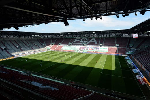 A picture shows the empty stadium during the German first division Bundesliga football match FC Augsburg v VfL Wolfsburg on May 16, 2020 in Augsburg, southern Germany.