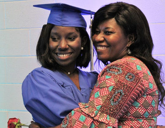 Graduate Jochebed Oduro is hugged by her mother, Patience, for a photo.