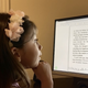 A student from Holy Trinity Episcopal Academy in Melbourne engages in a virtual reading lesson during the COVID-19 school closures.