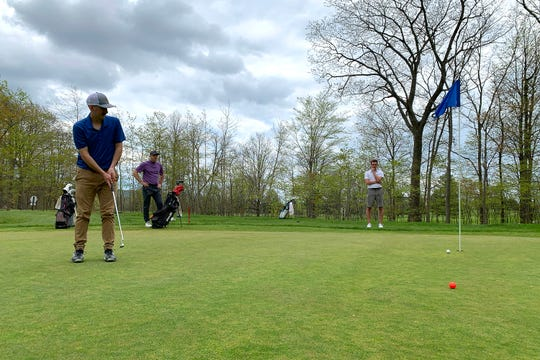 Jake Orr, left, watches his birdie putt roll toward the cup on the par-4 eighth hole at Champlain Country Club during a round on Saturday, May 16, 2020.