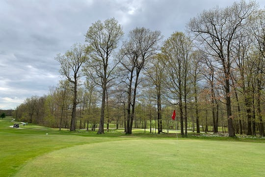 The sun breaks through the clouds to shine on the sixth green at Champlain Country Club during a round of golf on Saturday, May 16, 2020.