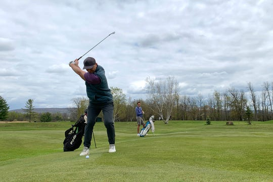Evan Russell hits his second shot on the par-5 second hole at Champlain Country Club during a round on Saturday, May 16, 2020.