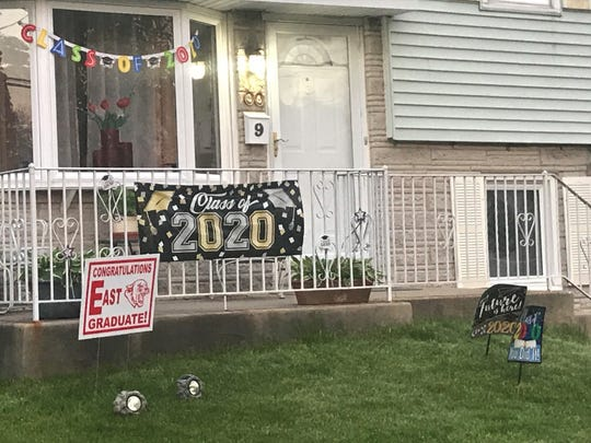 Cherry Hill families are decorating lawns to celebrate the township's graduates.