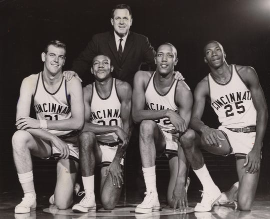 Cincinnati starters from 1961-1962 team standing up: Coach Ed Jucker. kneeling left to right: Ron Bonham, Capt. Tony Yates, George Wilson and Tom Thacker. They were the 1962 NCAA championship team.