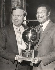 JANUARY 1, 1988: Pete Gillen (left) and Tony Yates hold the Crosstown Shootout trophy.