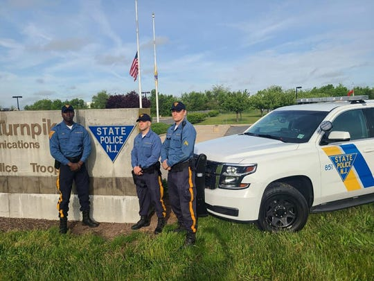 "New Jersey State Troopers Robert Murray, Pierre Noel and Marcin Ziobron, of Troop ""D"" Cranbury Station,  assisted in a delivery of a baby girl at Exit 8A on the Turnpike Saturday."