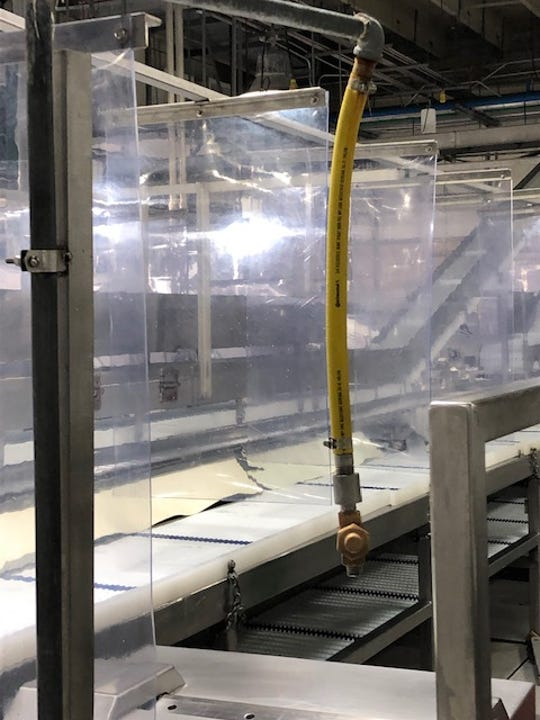 In photos provided by Tyson Meats, the company installed clear dividers at work stations in their Waterloo plant
