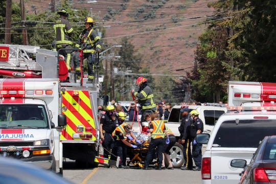 First responders transport an injured person on a stretcher Sunday at the scene of a crash involving a Canadian Forces Snowbirds aircraft in Kamloops, British Columbia.